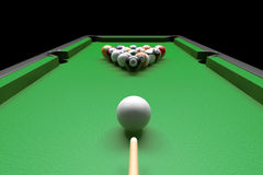 Billiard table with balls set and cues Stock Image