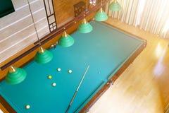 Billiard table close up. Playing billiard. Billiards balls and cue on green billiards table. Billiard sport concept. Pool billiard. Game. Home interior stock images