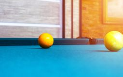 Billiard table close up. Playing billiard. Billiards balls and cue on green billiards table. Billiard sport concept. Pool billiard. Game royalty free stock image