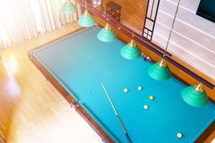 Billiard table close up. Playing billiard. Billiards balls and cue on green billiards table. Billiard sport concept. Pool billiard. Game. Home interior stock image