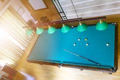 Billiard table close up. Playing billiard. Billiards balls and cue on green billiards table. Billiard sport concept. Pool billiard. Game. Home interior royalty free stock photography