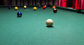 Billiard table with colorful balls. Action and arrangement backdrop background ball balls bar beginning billards billiard blur close cloth club color colorful Royalty Free Stock Image
