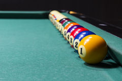 Billiard table with colorful balls, ranging from game soft focus. Billiard bar, nightclub,  billiards,entertainment first focus from gambling game geometry Stock Image