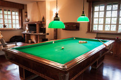 Billiard table with mock tiger skin rug Stock Photography
