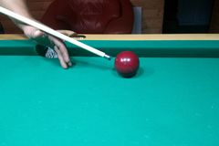 Billiard table and one billiard table with a cue stock image