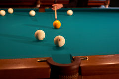 Billiard table - playing. Balls and a cue on a billiard table - playing Royalty Free Stock Images