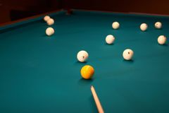 Billiard table - playing. Balls and a cue on a billiard table - playing Stock Photos