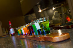 On a billiard table stand with coloured glasses of alcohol. Billiards, balls and stack Stock Images