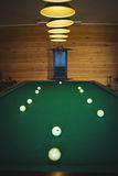Billiard table. With white balls and cue Stock Image