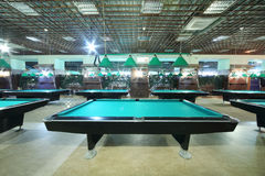 Billiard tables inside club Royalty Free Stock Images
