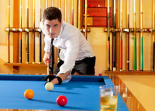Billiard winner handsome man playing Royalty Free Stock Photos