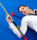 Billiard young man player lying on pool blue table Royalty Free Stock Photo