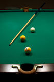 Billiards. The game of billiards on a table with green cloth Stock Photos