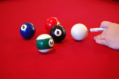 Billiards. It takes a steady hand to make a difficult shot Stock Image