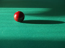 Billiards. One brown billiard ball on the green table Stock Image