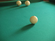 Billiards. Three white billiard spheres on a green table Royalty Free Stock Images