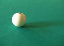 Billiards. One white billiard sphere on a green table Stock Image