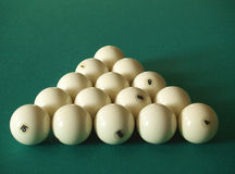 Billiards. Fifteen white billiard spheres on a green table Royalty Free Stock Photo