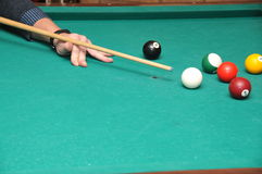 Billiards. A billiard stick and cue ball get ready to break Stock Image