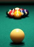 Billiards: 9-Ball Rack. This is a photo of a billiards game consisting of a close-up of a cue ball positioned in front of a 9 ball rack. The rack of billiard royalty free stock images