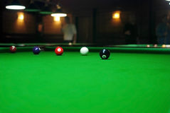 Billiards balls. On the green table Stock Images