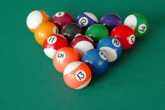 Billiards balls. Group of billiards balls on table in triangle position royalty free stock images