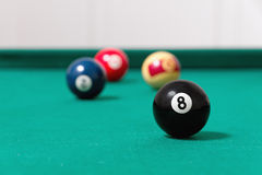 Billiards balls. Impregnating the billiards cue tip with the chalk Stock Image