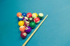 Billiards balls and cue on billiards table. Close up Stock Images