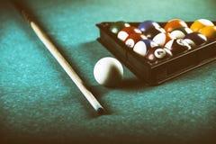 Billiards balls and cue on pool billiard table. Billiard sport concept. stock photos