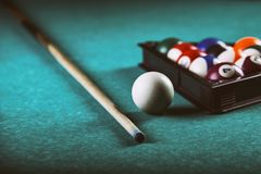 Billiards balls and cue on pool billiard table. Billiard sport concept. royalty free stock images
