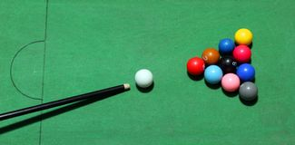 Billiards balls table. Billiards balls on the green table Stock Images
