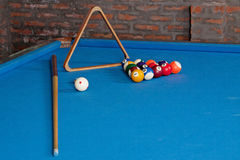 Billiards. billiard balls and cues on blue table. Blue cloth Billiards. billiard balls and cues on blue table royalty free stock photos