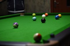 Billiards are on the billiard table. Billiards on the billiard table, randomly put out various shapes, interesting patterns Stock Photos