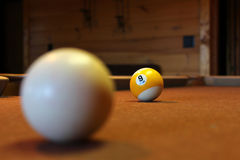 Billiards. Brown billiard table with cue ball Royalty Free Stock Photography