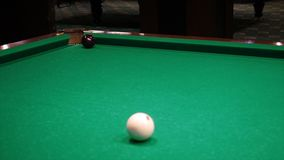 Billiards. Close-up of someone aiming the billiard ball with cue. Billiards game.  Royalty Free Stock Photography