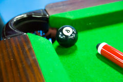 Billiards. Closeup shot of black ball going in billiard pocket Stock Photography