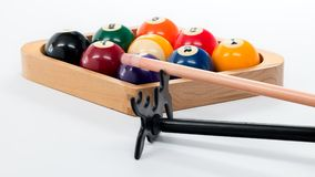 Pool nine Ball rack with a bridge and cue stick. Billiards game with balls rack and cue Royalty Free Stock Images