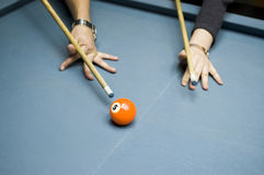 Billiards lesson. A billiards lesson on how to bridge and hit stock images