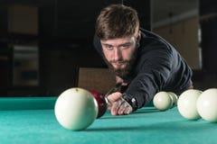 Billiards. man plays billiards. leisure. cue royalty free stock photos