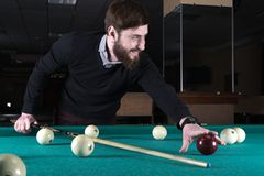 Billiards. man plays billiards. leisure. cue stock photo