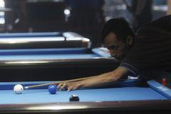 Billiards. Player competing in national billiards championship in solo central java, indonesia royalty free stock photography