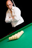 Billiards player standing behind pool table Royalty Free Stock Photography