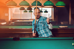 Billiards player wins an important match Stock Photos