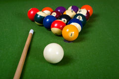 Billiards of Pool. A set of billiards or pool balls on a green flet table with copy space Royalty Free Stock Photography