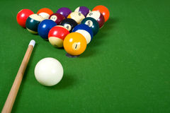 Billiards of Pool. A set of billiards or pool balls on a green flet table with copy space royalty free stock images