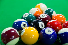 Billiards. Pool game on green table Royalty Free Stock Photo