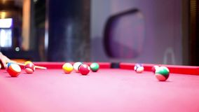Billiards pool game in the night bar. Beat cue Royalty Free Stock Images