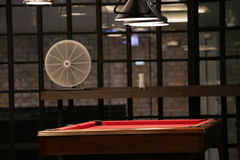 Billiards pool table in relax room. Red billiard/pool table in glass room Stock Photo