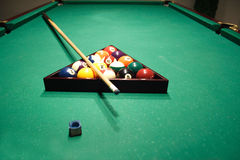 Billiards table with balls and cue Royalty Free Stock Image