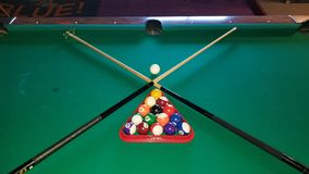 Cross cues. Billiards table and cues crosed royalty free stock photography
